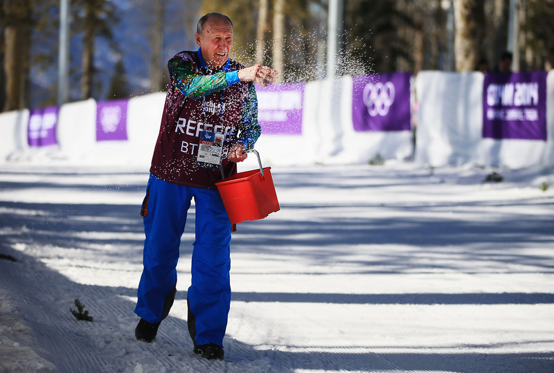 . A crew member tends the course during the Women\'s 10 km Classic during day six of the Sochi 2014 Winter Olympics at Laura Cross-country Ski & Biathlon Center on February 13, 2014 in Sochi, Russia.  (Photo by Richard Heathcote/Getty Images)