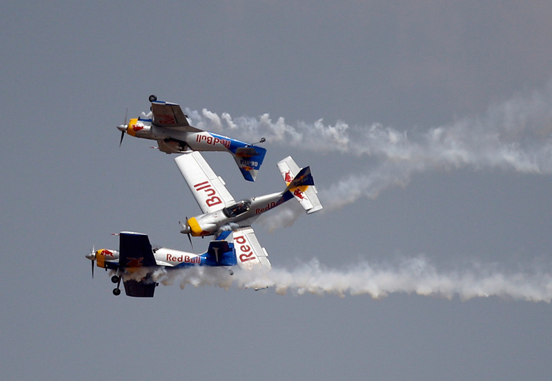 . Flying Bulls Zlin 50LX single-engine and single-seater aerobatic display team from the Czech Republic performs on the third day of the Aero India 2013 at Yelahanka air base in Bangalore, India, Friday, Feb. 8, 2013. More than 600 aviation companies along with delegations from 78 countries are participating in the five-day event that started Wednesday. (AP Photo/Aijaz Rahi)