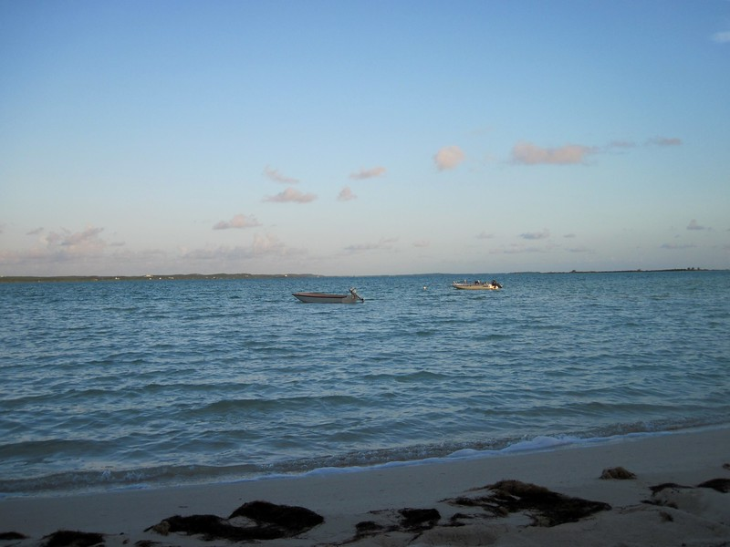 The boats moored off the beach