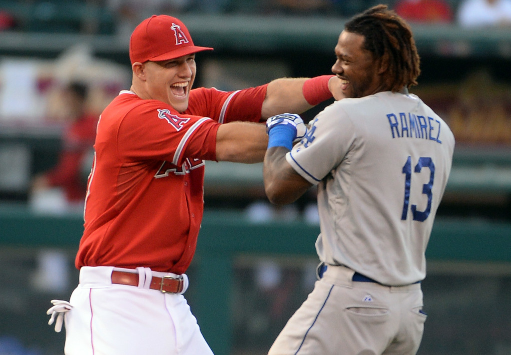 . Los Angeles Angels\' Mike Trout, left, has fun with Los Angeles Dodgers\' Hanley Ramirez prior to a baseball game at Anaheim Stadium in Anaheim, Calif., on Thursday, Aug. 7, 2014.  (Photo by Keith Birmingham/ Pasadena Star-News)