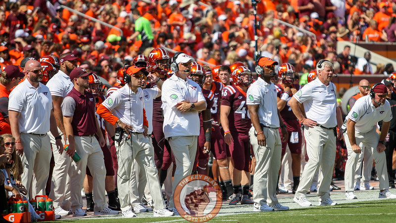 The Virginia Tech coaching staff watches the offense from the sidelines in the third quarter.  (Mark Umansky/TheKeyPlay.com)