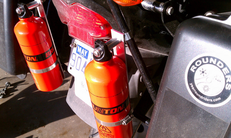 Here's a quick fuel bottle mounting rig. These 1 litre Brunton bottles paid for themselves the first trip.  ( and yes I ran out of gas )