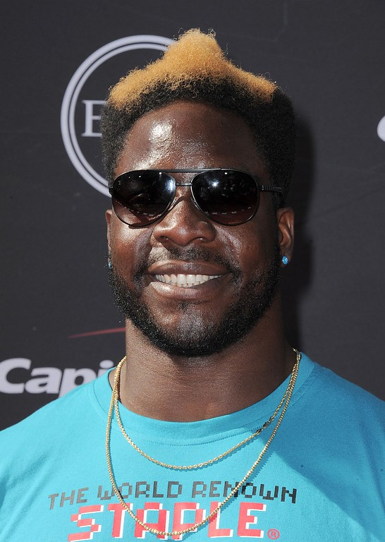 . Oakland Raiders\' Lamarr Houston arrives at the ESPY Awards on Wednesday, July 17, 2013, at Nokia Theater in Los Angeles. (Photo by Jordan Strauss/Invision/AP)