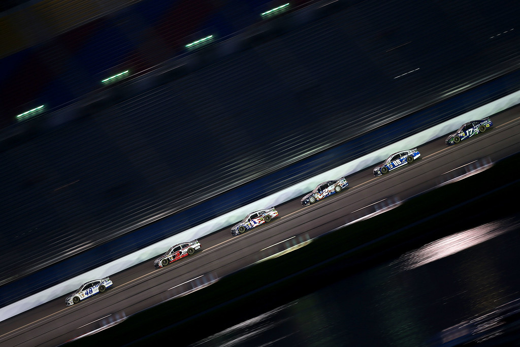 . DAYTONA BEACH, FL - JULY 06:  Jimmie Johnson, driver of the #48 Lowe\'s Dover White Chevrolet, leads a pack of cars during the NASCAR Sprint Cup Series Coke Zero 400 at Daytona International Speedway on July 6, 2013 in Daytona Beach, Florida.  (Photo by Mike Ehrmann/Getty Images)