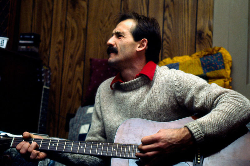 Terry playing his guitar at his house. 1985