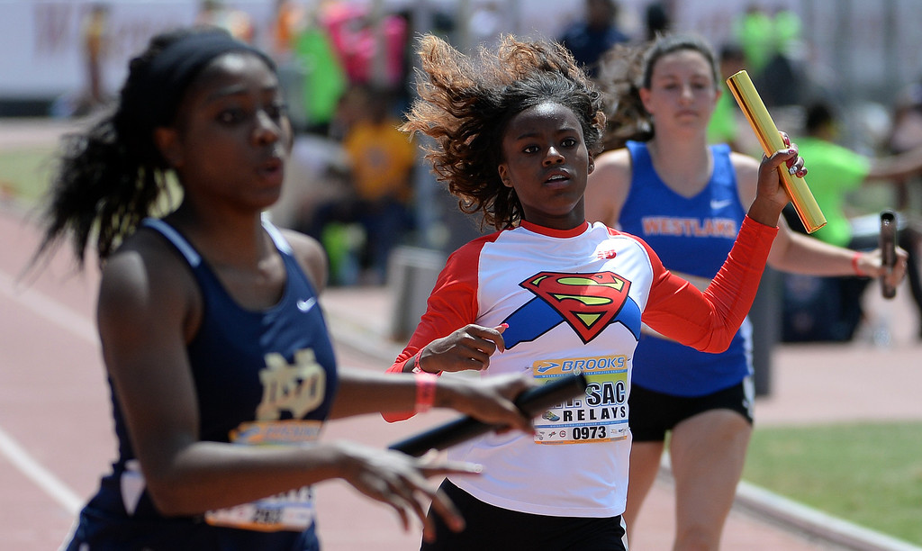 . Serra competes in the 4x100 meter relay Invitational during the Mt. SAC Relays in Hilmer Lodge Stadium on the campus of Mt. San Antonio College in Walnut, Calif., on Saturday, April 19, 2014. 