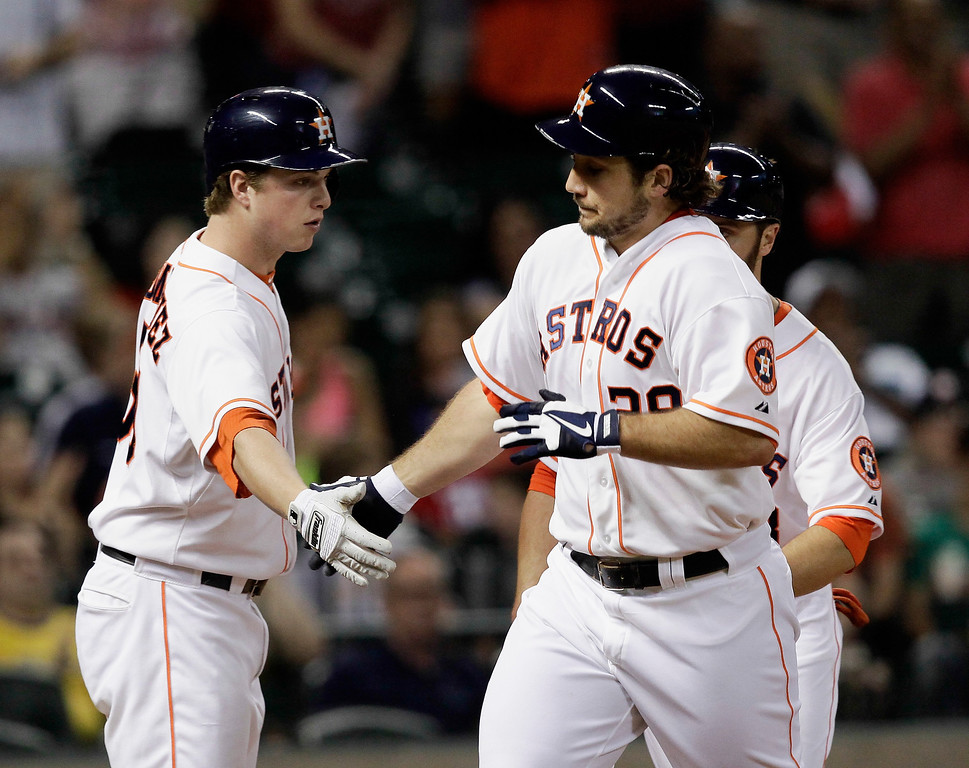. HOUSTON, TX - SEPTEMBER 14:  Brett Wallace #29 of the Houston Astros is congratulated by Matt Dominguez #30 of the Houston Astros after hitting a home run in the fourth inning against the Los Angeles Angels of Anaheim at Minute Maid Park on September 14, 2013 in Houston, Texas.  (Photo by Bob Levey/Getty Images)