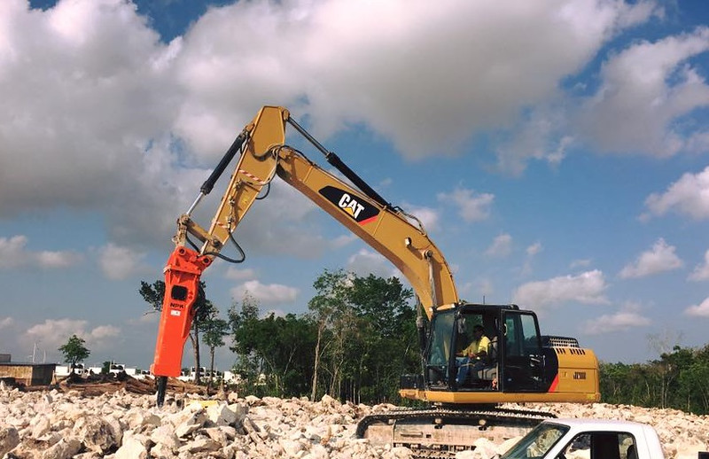 NPK GH9 hydraulic hammer with Enviro bracket on Cat excavator - secondary rock breaking (1).jpg