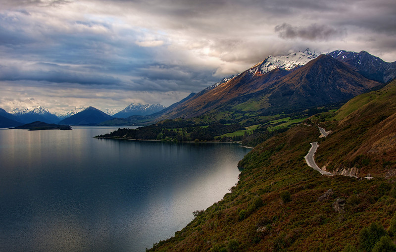 The Most Beautiful Road in the World I found it!I've looked at travel guides and driven on a ton of beautiful, scenic roads all over the world, but I think this road to Queenstown (on the way to/from Glenorchy) is the most beautiful in the world.  The road winds down one side of a perfect, fjord-like lake, and every few kilometers, the mountain views change dramatically.  Depending upon the time of day you travel it, the entire landscape transforms before your eyes.Wonder what it looks like on the other side of the lake?  You won't believe that it is in the same place!  See this photo called Mountainstorm that I took on a previous trip to this location.  It was shot later in the evening, so I wasn't able to properly capture the road that time.What's the prettiest road you have ever found?  I've seen conflicting guides of the most beautiful roads in the US... I'm sure everyone has their opinion... I'd love to know what you think!- Trey RatcliffClick here to read the rest of this post at the Stuck in Customs blog.