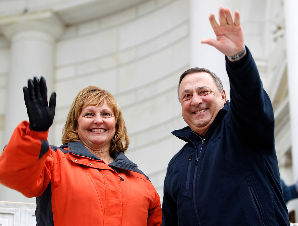 . Gov. Paul LePage of Maine and his wife Ann wave to the crowd during the laying of wreaths at Arlington National Cemetery in Arlington, Va. on Saturday, Dec. 15, 2012, during Wreaths Across America Day. Wreaths Across America was started in 1992 at Arlington National Cemetery by Maine businessman Morrill Worcester and has expanded to hundreds of veterans\' cemeteries and other locations in all 50 states and beyond.  (AP Photo/Jose Luis Magana)