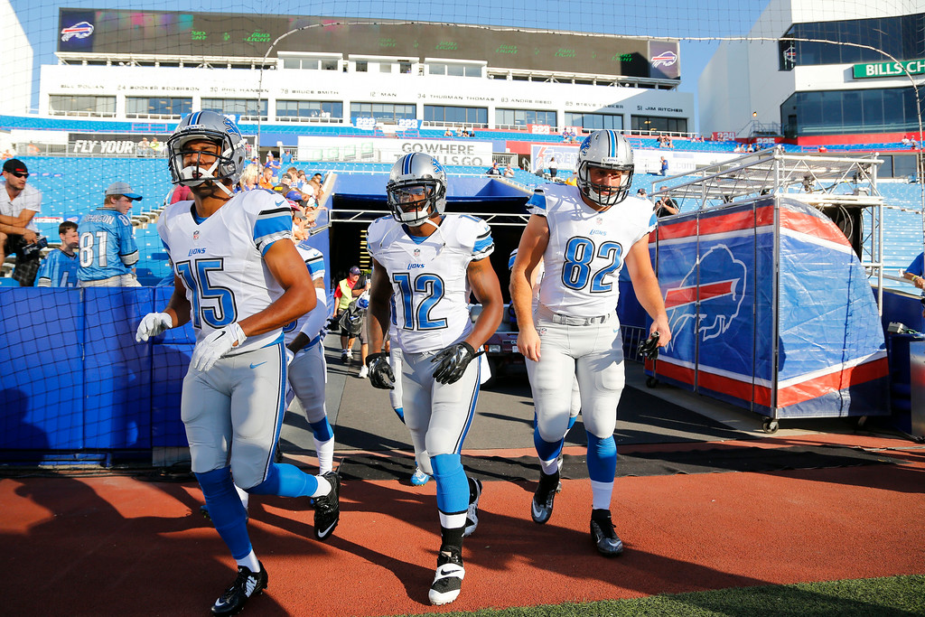 . Detroit Lions\' Golden Tate (15), Jeremy Ross (12) and Jordan Thompson (82) take the field for warm ups before a preseason NFL football game against the Buffalo Bills, Thursday, Aug. 28, 2014, in Orchard Park, N.Y. (AP Photo/Bill Wippert)