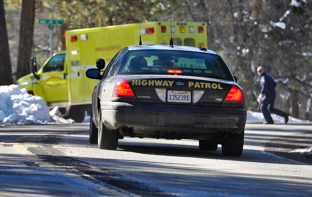 . California Highway Patrol and paramedics race to the scene where fugitive Christopher Dorner may have been sited near Highway 38 near Barton Flats in the San Bernardino Mountains on Tuesday, Feb. 12, 2013. (Rachel Luna / Staff Photographer)