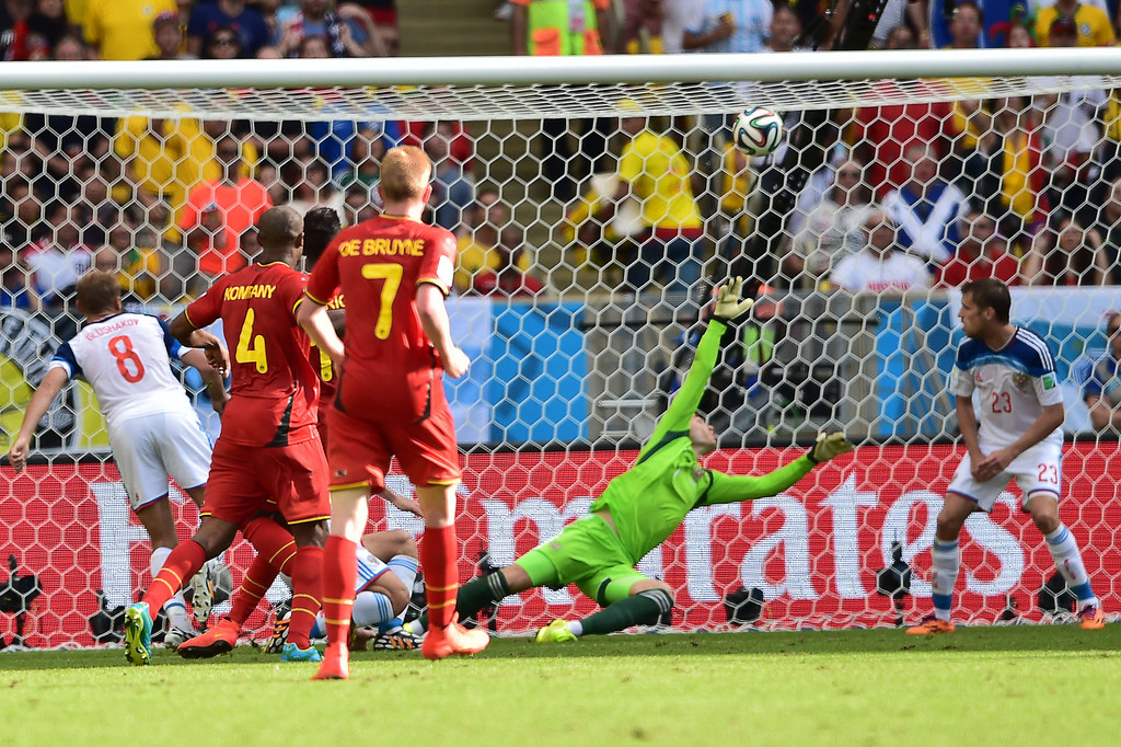. Russia\'s goalkeeper Igor Akinfeev (2R) fails to stop a shot from an obscured Belgium\'s forward Divock Origi to score a goal during the Group H football match between Belgium and Russia at The Maracana Stadium in Rio de Janeiro on June 22, 2014, during the 2014 FIFA World Cup. AFP PHOTO / GABRIEL BOUYS