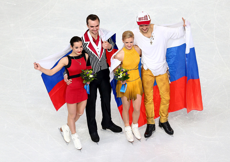 . (L-R) Silver medalists Ksenia Stolbova and Fedor Klimov of Russia, gold medalists Tatiana Volosozhar and Maxim Trankov of Russia pose after the flower ceremony for the Figure Skating Pairs event during day five of the 2014 Sochi Olympics at Iceberg Skating Palace on February 12, 2014 in Sochi, Russia.  (Photo by Clive Mason/Getty Images)