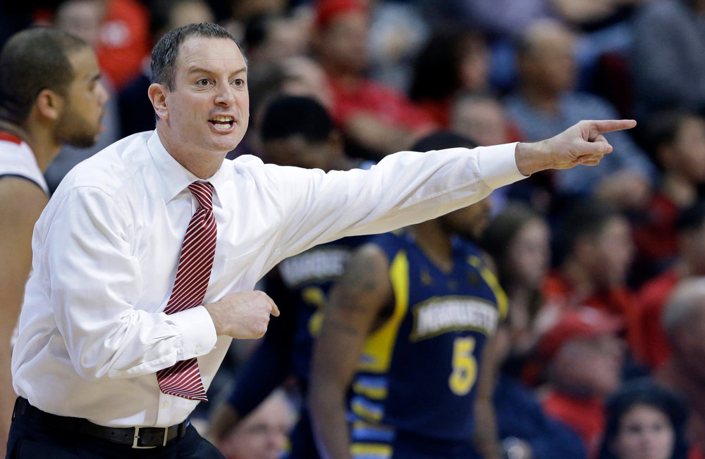 . Rutgers coach Mike Rice shouts to his players during the second half of an NCAA college basketball game against on Marquette Tuesday, March 5, 2013, in Piscataway, N.J. Marquette won 60-54. (AP Photo/Mel Evans)