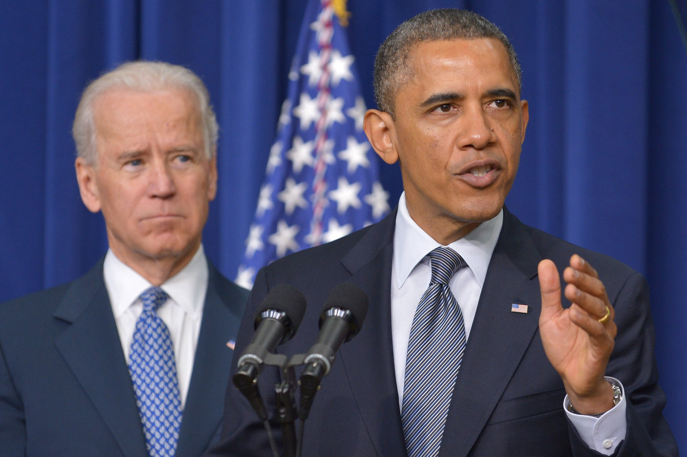. US President Barack Obama speaks on proposals to reduce gun violence as Vice President Joe Biden watches on January 16, 2013 in the South Court Auditorium of the Eisenhower Executive Office Building, next to the White House in Washington, DC. President Obama Wednesday will sign 23 executive actions to curb gun violence and demand Congress pass an assault weapons ban and other sweeping measures in response to the Newtown massacre. A senior official also said Obama would call on Congress to pass deeper measures, including bans on high-capacity magazine clips of more than 10 rounds and to prohibit armor-piercing bullets. AFP PHOTO/Mandel  NGAN/AFP/Getty Images