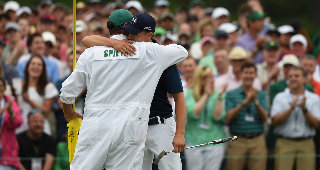 . Jordan Spieth of the US hugs caddie, Michael Greller, as he celebrates winning the 79th Masters Golf Tournament at Augusta National Golf Club on April 12, 2015, in Augusta, Georgia.  DON EMMERT/AFP/Getty Images
