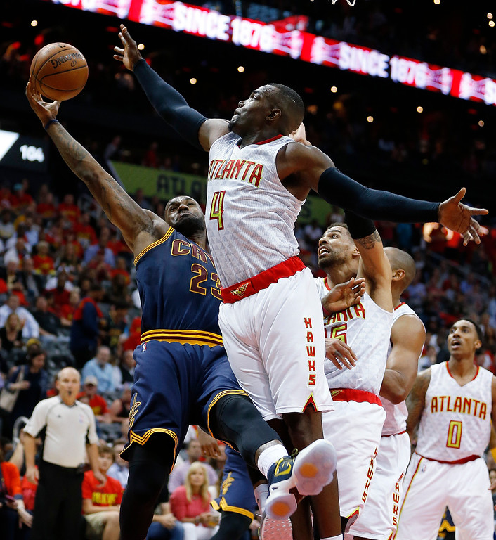 . Cleveland Cavaliers forward LeBron James (23) shoots against Atlanta Hawks forward Paul Millsap (4) in the second half of Game 3 of the second-round NBA basketball playoff series, Friday, May 6, 2016, in Atlanta. (AP Photo/John Bazemore)