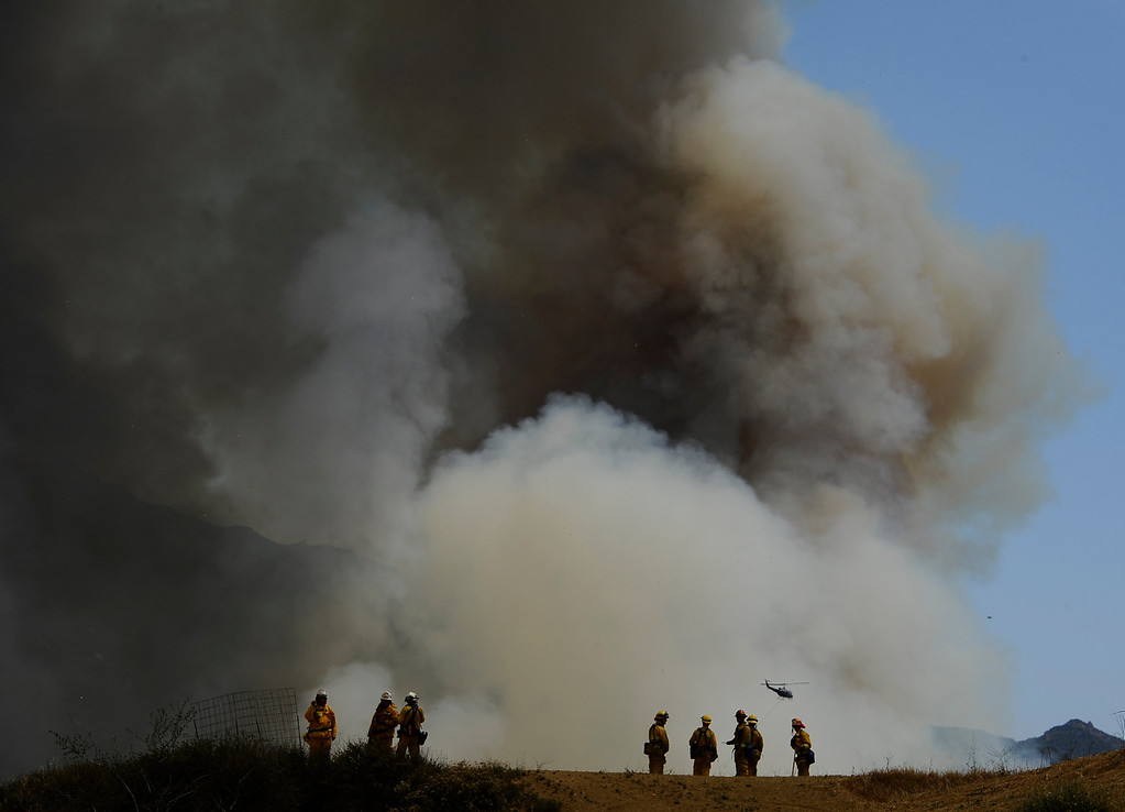 . Huge blooms of smoke go up like a volcano in the canyon areas during the second day of the Springs Fire in the mountain areas of Ventura County CA.  May 3, 2013. A fierce, wind-whipped brush fire spread on Friday along the California coast northwest of Los Angeles, threatening several thousand homes and a military base as more than 1,100 dwellings were ordered evacuated and a university campus was closed. May 2,2013. Ventura County California.  Photo by Gene Blevins/LA Daily News