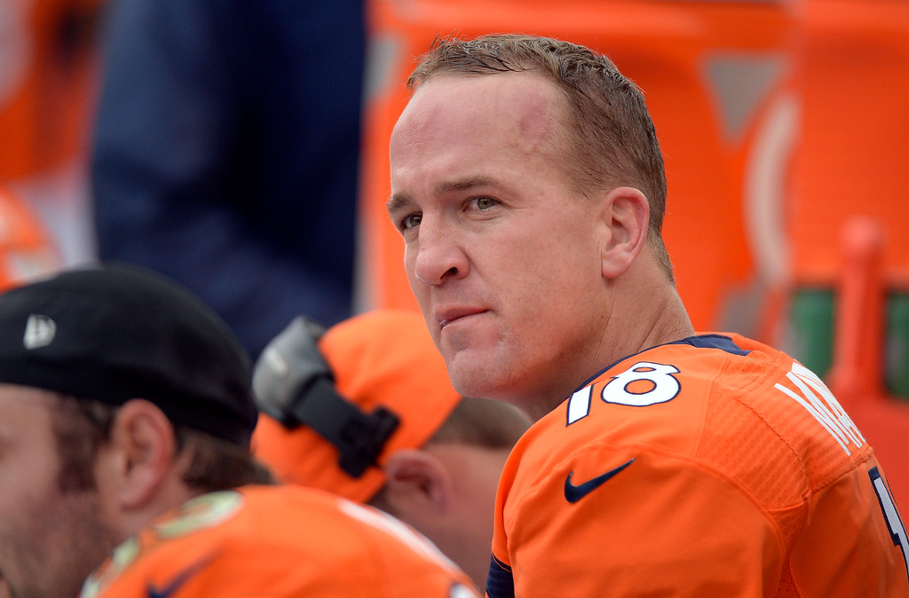 . Denver Broncos quarterback Peyton Manning (18) looks up at the scoreboard from the bench against the Philadelphia Eagles September 29, 2013 at Sports Authority Field at Mile High in Denver . (Photo by John Leyba/The Denver Post)