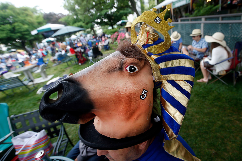. Carlo Spano, of Lindenhurst, N.Y., wears an American Pharoah hat before the 147th running of the Belmont Stakes horse race at Belmont Park, Saturday, June 6, 2015, in Elmont, N.Y.  American Pharoah will try for a Triple Crown when he runs in Saturday\'s race. (AP Photo/Jason DeCrow)