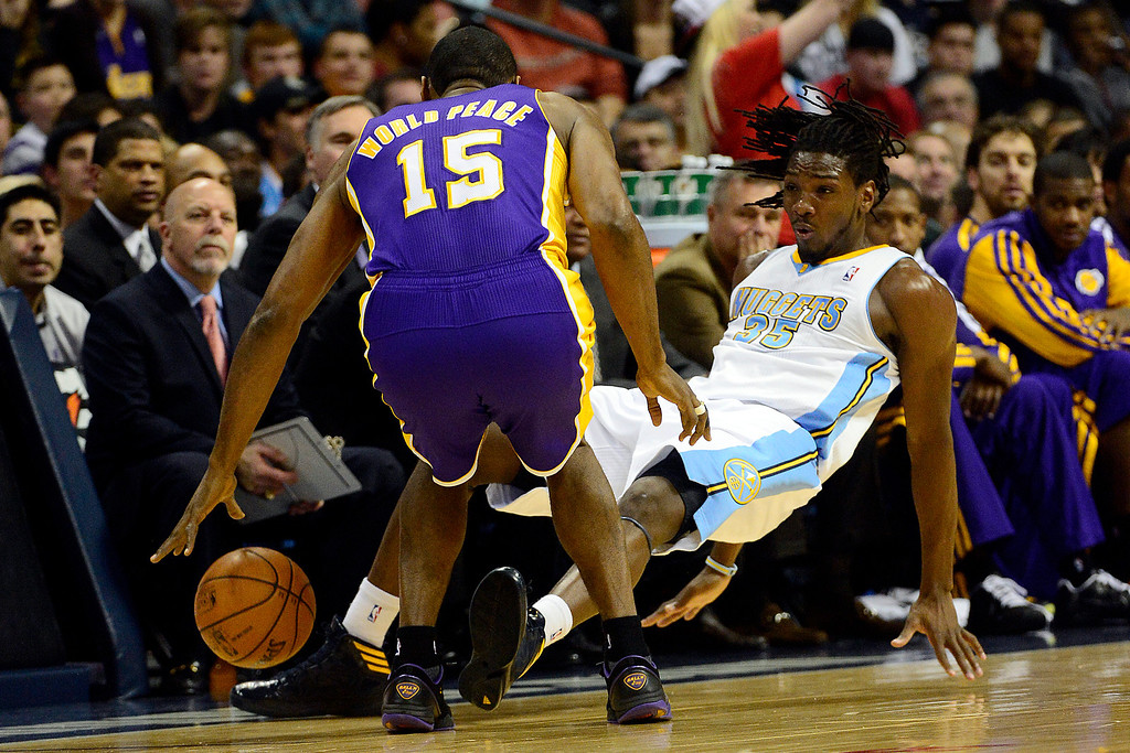 . Denver Nuggets small forward Kenneth Faried (35) hits the deck after taking contact from Los Angeles Lakers small forward Metta World Peace (15) during the first half at the Pepsi Center on Wednesday, December 26, 2012. AAron Ontiveroz, The Denver Post