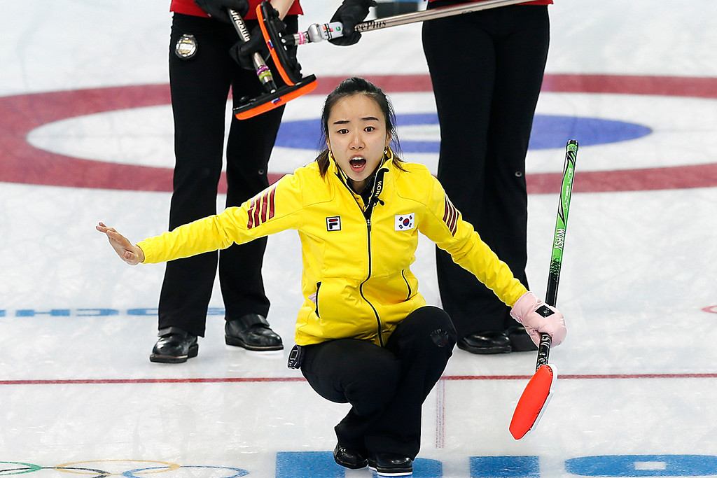 . South Korea\'s skip Kim Ji-sun shouts instructions to her teammates during the women\'s curling competition against Russia at the 2014 Winter Olympics, Thursday, Feb. 13, 2014, in Sochi, Russia. (AP Photo/Wong Maye-E)