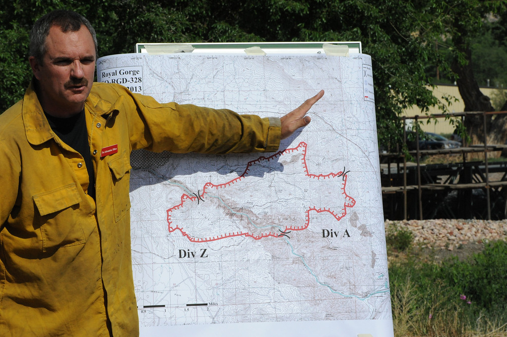 . Gregg Goodland, fire information officer for the Royal Gorge Fire, explains the perimeter of the fire during a Wednesday morning press conference. Michael Alcala/Daily Record