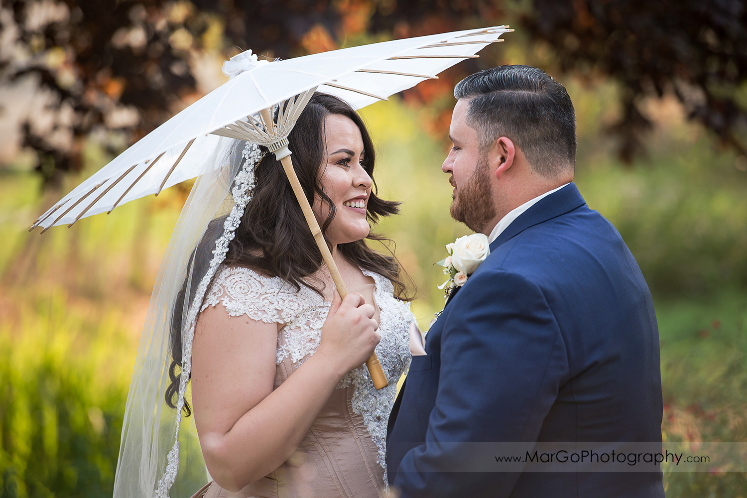 bride and groom looking at each other during first look at Taber Ranch Vineyards