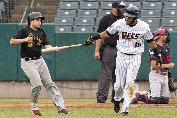 The New Britain Bees vs the Southern Maryland Blue Crabs in a noon start double header on Thursday July 18, 2019. Jonathan Galvez (10) hands his bat the Bees batboy after drawing a walk. | Wesley Bunnell | Staff