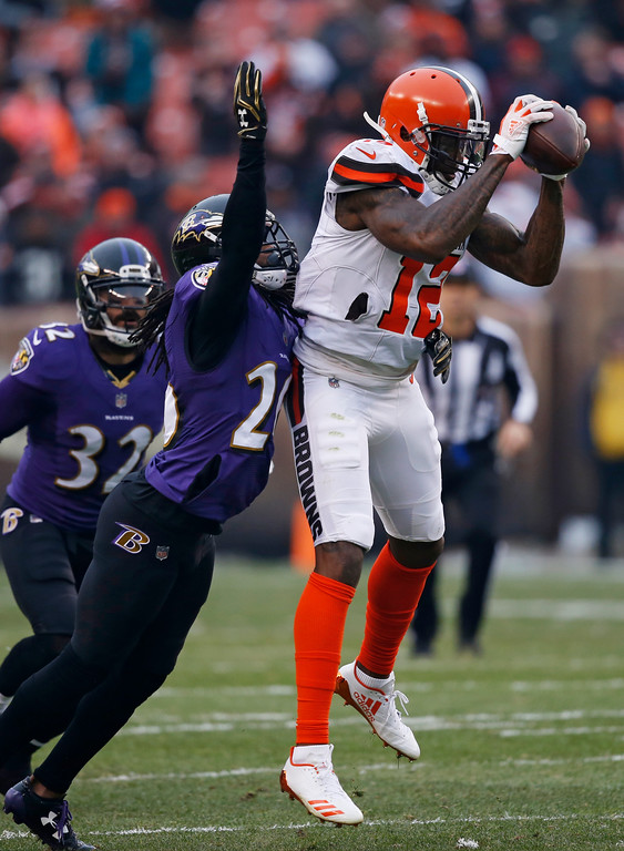 . Cleveland Browns wide receiver Josh Gordon (12) catches a pass against the Baltimore Ravens during the first half of an NFL football game, Sunday, Dec. 17, 2017, in Cleveland. (AP Photo/Ron Schwane)