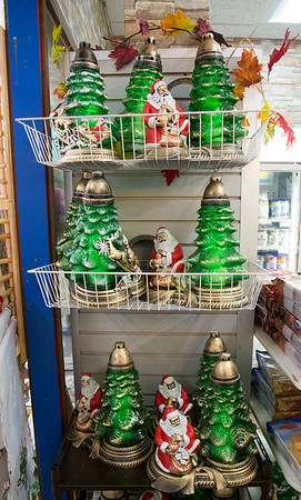 12/11/19 Wesley Bunnell | StaffrrCandle holders and Santa decorations at Polmart located at 123 Broad St on Wednesday December 11, 2019.