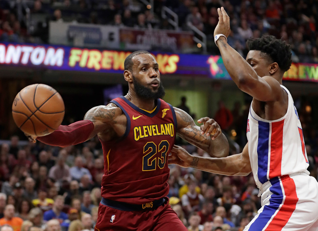 . Cleveland Cavaliers\' LeBron James (23) passes against Detroit Pistons\' Stanley Johnson (7) in the first half of an NBA basketball game, Sunday, Jan. 28, 2018, in Cleveland. (AP Photo/Tony Dejak)