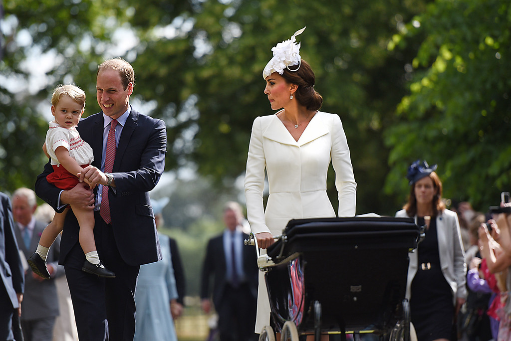 . Catherine, Duchess of Cambridge, Prince William, Duke of Cambridge, Princess Charlotte of Cambridge and Prince George of Cambridge walk past crowds as they leave the Church of St Mary Magdalene on the Sandringham Estate after the Christening of Princess Charlotte of Cambridge on July 5, 2015 in King\'s Lynn, England.  (Photo by Mary Turner - WPA Pool/Getty Images)