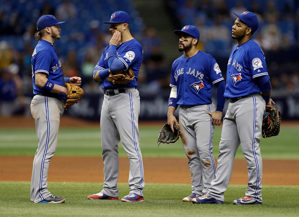 . Toronto Blue Jays infielders, from left, third baseman Josh Donaldson, shortstop Troy Tulowitzki, second baseman Devon Travis and first baseman Edwin Encarnacion wait during a pitching change against the Tampa Bay Rays during the sixth inning of a baseball game Saturday, Sept. 3, 2016, in St. Petersburg, Fla. (AP Photo/Chris O\'Meara)