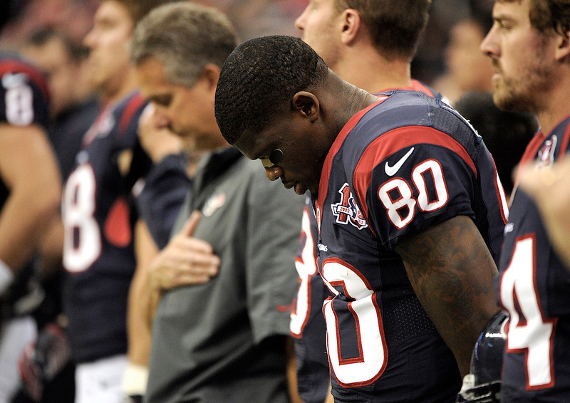 . Houston Texans wide receiver Andre Johnson (80) bows his head before an NFL football game against the Indianapolis Colts Sunday, Dec. 16, 2012, in Houston. (AP Photo/Dave Einsel)