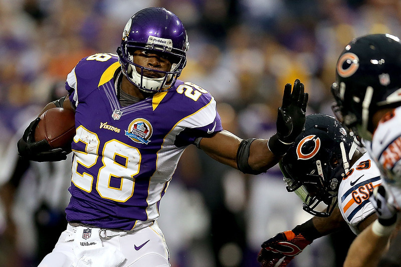 . Adrian Peterson #28 of the Minnesota Vikings carries the ball against the Chicago Bears at Mall of America Field on December 9, 2012 in Minneapolis, Minnesota.  (Photo by Matthew Stockman/Getty Images)