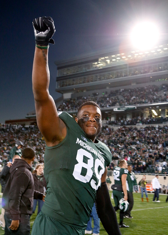. Michigan State\'s Shilique Calhoun celebrates following a 35-11 win over Michigan in an NCAA college football game, Saturday, Oct. 25, 2014, in East Lansing, Mich. (AP Photo/Al Goldis)