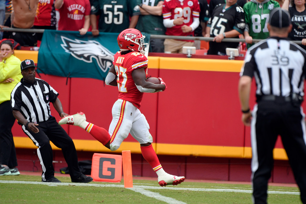 . Kansas City Chiefs running back Kareem Hunt (27) runs for a 53 yard touchdown, during the second half of an NFL football game in Kansas City, Mo., Sunday, Sept. 17, 2017. (AP Photo/Ed Zurga)