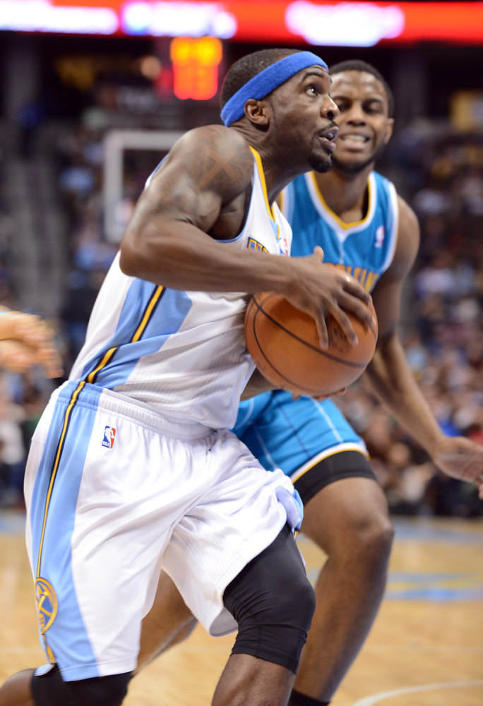 . DENVER, CO. - FEBRUARY 01: Ty Lawson of Denver Nuggets #3 drives past Darius Miller of New Orleans Hornets #2 in the 1st half of the game on February 1, 2013 at the Pepsi Center in Denver, Colorado. (Photo By Hyoung Chang/The Denver Post)