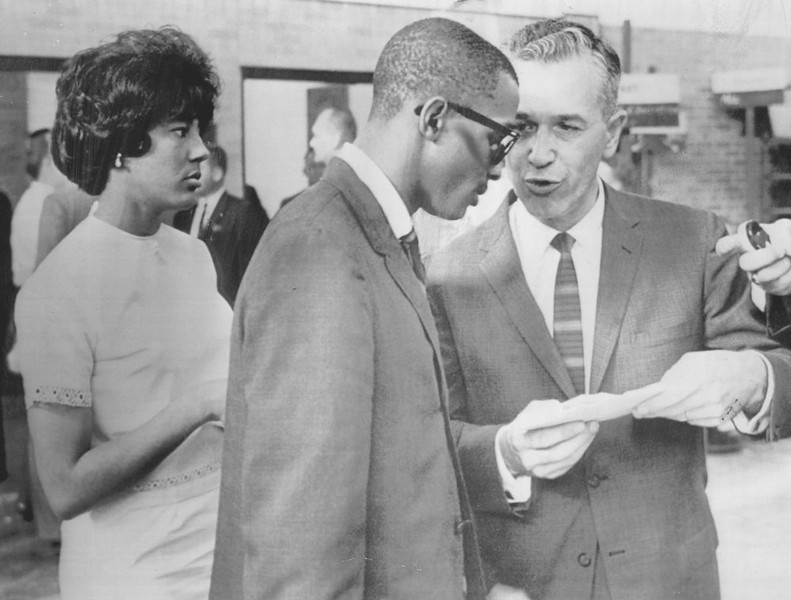 . Dean of admissions, Herbert Mate, right, confers with Vivian Malone and James Hood after the two were registered at the University of Alabama in Tuscaloosa Tuesday. (The Denver Post Archive)