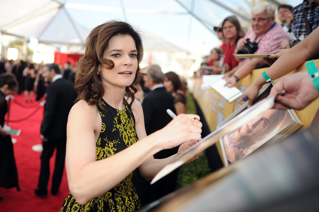 . Betsy Brandt signs autographs on the red carpet at the 20th Annual Screen Actors Guild Awards  at the Shrine Auditorium in Los Angeles, California on Saturday January 18, 2014 (Photo by Hans Gutknecht / Los Angeles Daily News)