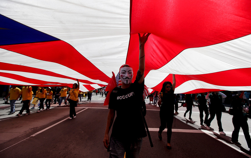 . Marchers participate during a May Day rally in downtown Los Angeles, Wednesday, May 1, 2013. In celebration of May Day thousands have gathered for an immigration reform rally in downtown. (AP Photo/Jae C. Hong)