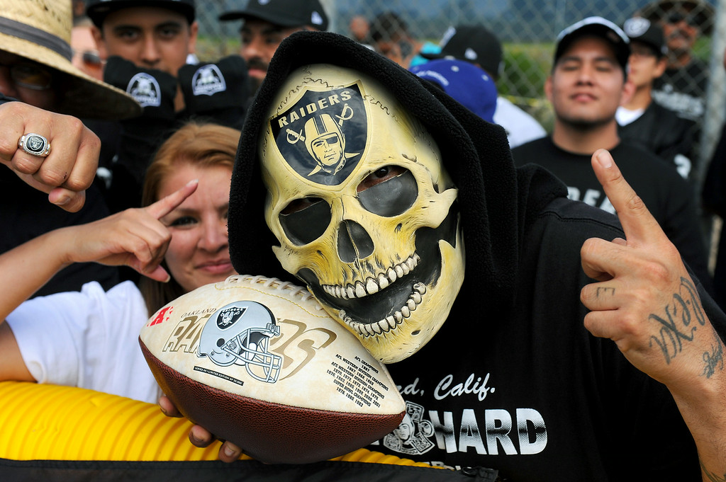 ". ""Raider Ray\"" wears a mask to the Cowboys-Raiders practice in Oxnard, Wednesday, August 13, 2014. (Photo by Michael Owen Baker/Los Angeles Daily News)"