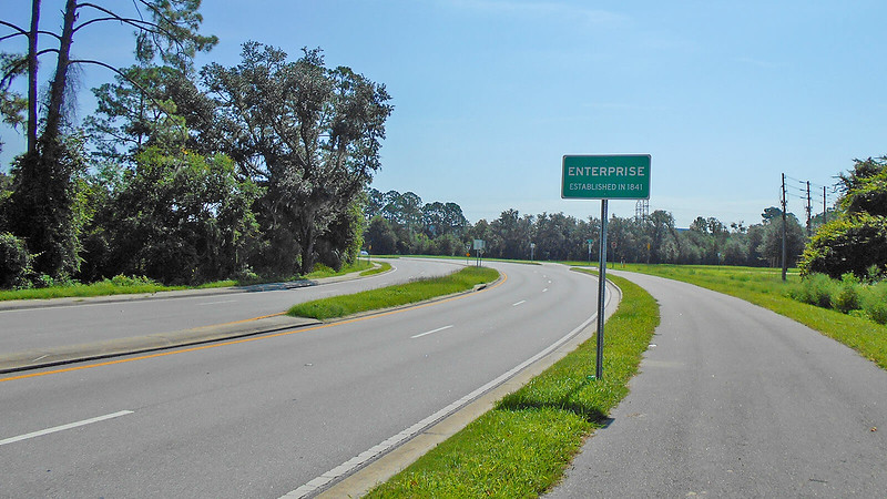 Enterprise sign and curve in road next to bike path