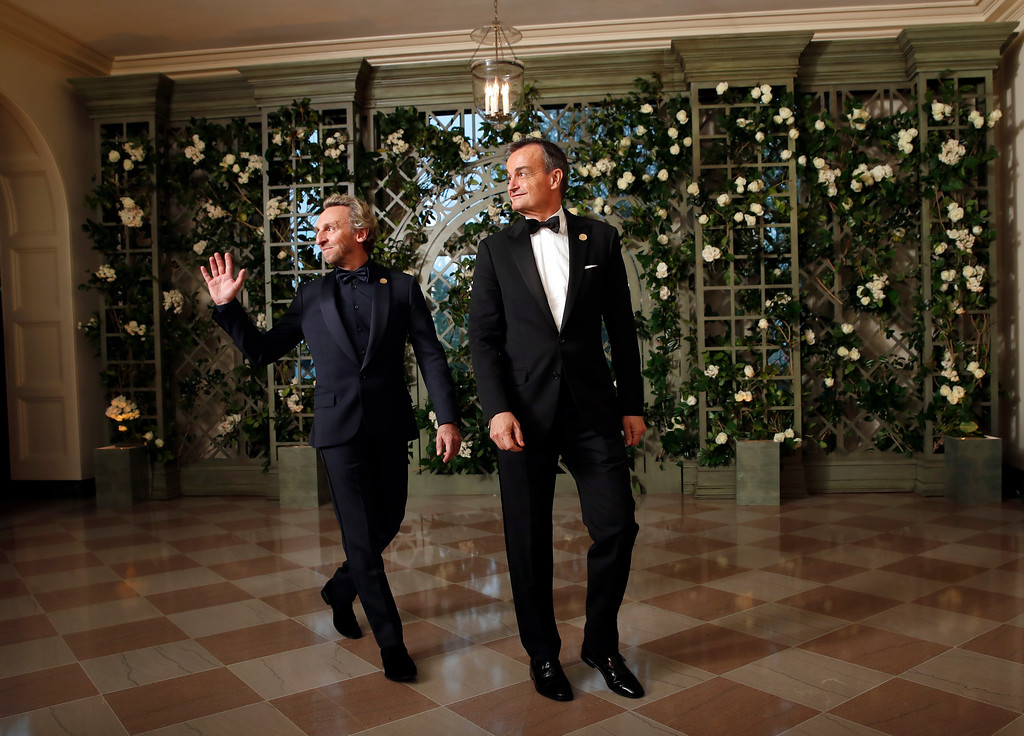 . Pascal Blondeau, left, and Gérard Araud, Ambassador of France to the United States, arrive for a State Dinner with French President Emmanuel Macron and President Donald Trump at the White House, Tuesday, April 24, 2018, in Washington. (AP Photo/Alex Brandon)