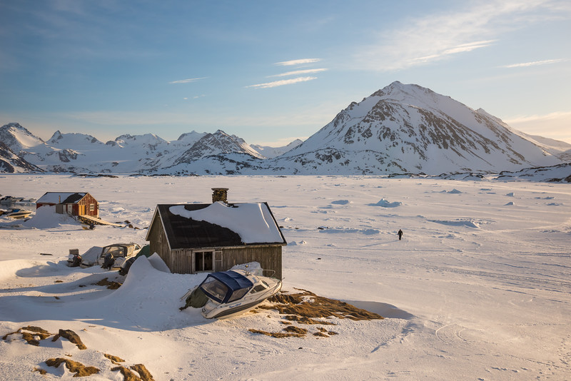 Inuit in Kulusuk bay at sunrise, East Greenland