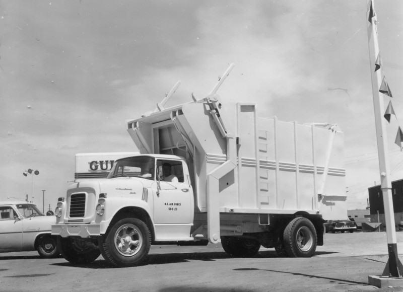 """This unusual looking truck is one of two sold to the U.S. Air Force Academy in 1958. The model BF-16-FL (Full-Pack) features side forks and two 6-1/4"""" cylinders that operate the packer blade. These Bowles full-pack models were listed as having telescopic packing cylinders, but this short-bodied version may have been able to make use of single-stage rams instead."""