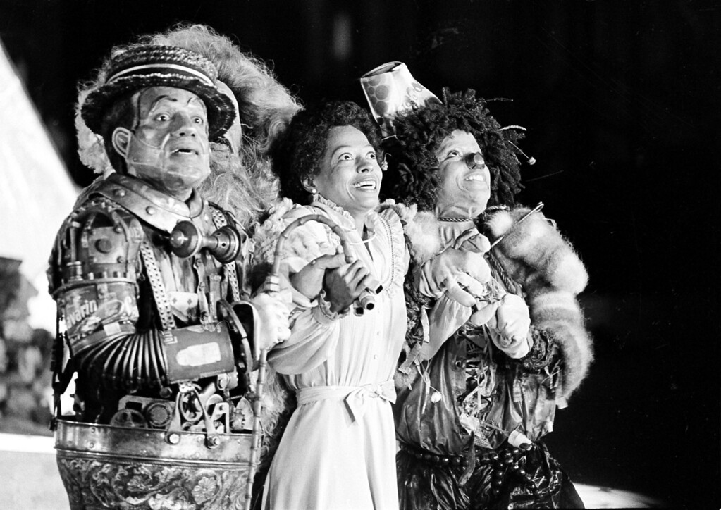 ". Diana Ross, center, as Dorothy, Michael Jackson, right, as Scarecrow, and Nipsey Russell as Tinman perform during filming of the musical ""The Wiz\"" in New York\'s World Trade Center, Tuesday, Oct. 4, 1977.  Ted Ross, portraying the Lion, is partly hidden behind Russell.  (AP Photo)"