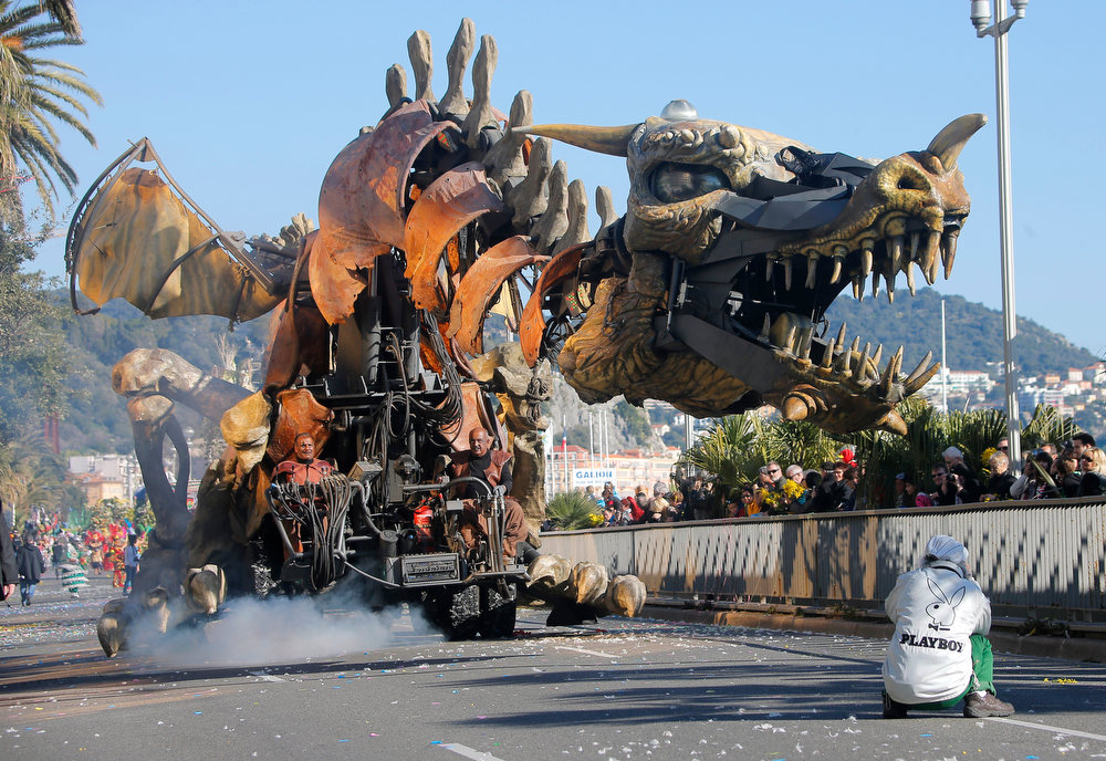 ". A float moves along the street during the flower parade of the 129th edition of the Nice Carnival, Saturday, Feb. 16, 2013, in Nice, southern France. The carnival celebrates the theme ""King of the 5 continents\"". (AP Photo/ Lionel Cironneau)"